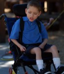 Young boy with physical and developmental disabilities