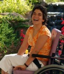 Young Woman with Developmental Disabilities smiles for camera