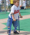 Young Cardinal fans uses his crutches to get from one base to the next!