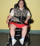 Woman with intellectual disabilities sits in her wheelchair