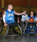 Another action shot of a wheelchair basketball game