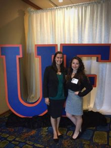 Claudia Friedel and Danielle Scheer stand in front of a large decorative UF letters