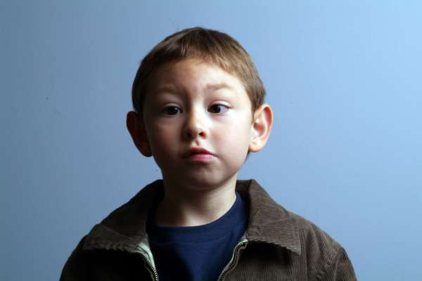 Young boy with vision impairment