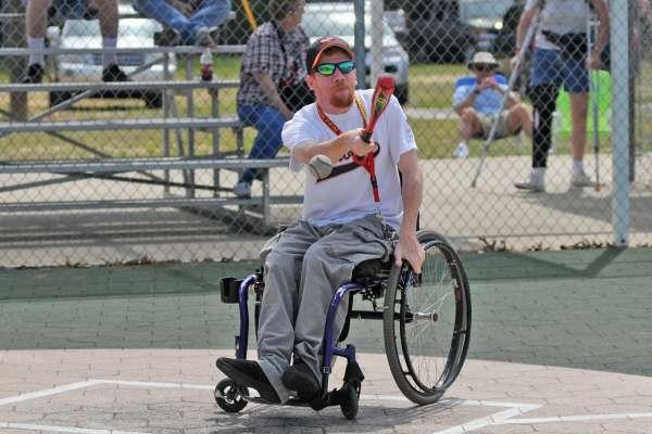 Man in a wheelchair swings the bat at a local baseball game
