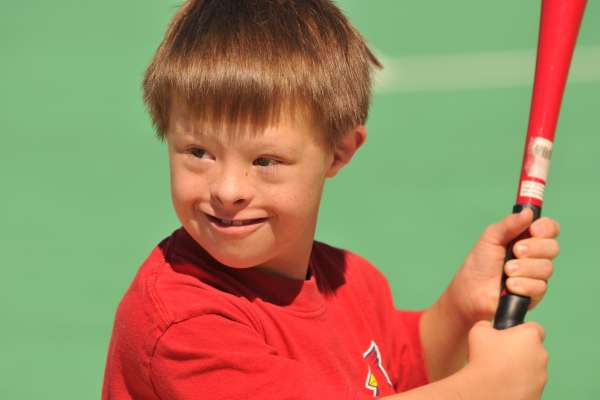 6 year old boy with Downs smiles for the camera