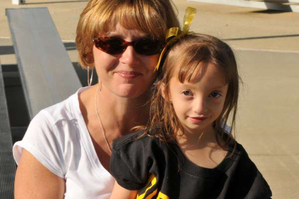 Young Pirates fan watches the game from the sidelines with her mother