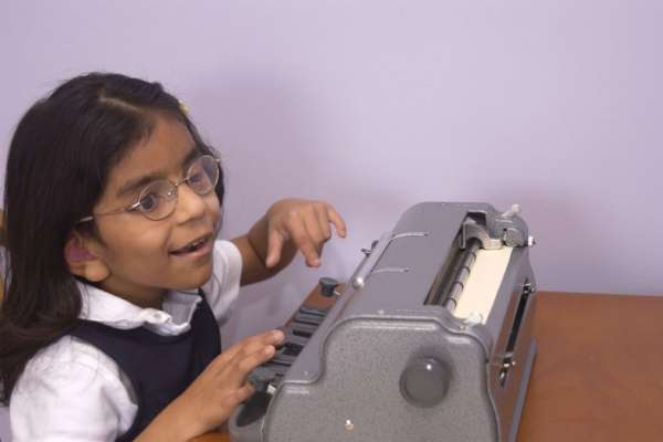 Image of young girl writing in braille